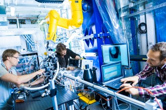 European XFEL scientists prepare the FXE instrument for an experiment. (Credit: European XFEL)
