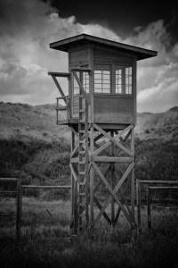 The guard tower still stands at the site of the Heart Mountain War Relocation Center near Cody, Wyoming. Named after nearby Heart Mountain, the center was one of ten concentration camps used for the internment of Japanese Americans evicted from the West Coast Exclusion Zone during World War II. The camp interned a total of 13,997 Japanese-Americans during its three-year existence.
