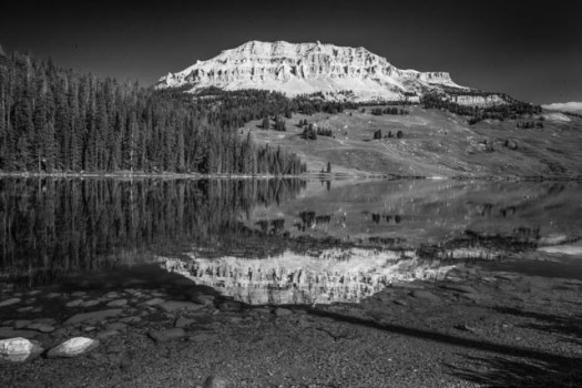 Beartooth Butte reflects in Beartooth lake along the Beartooth Highway, which runs between Montana and Wyoming.