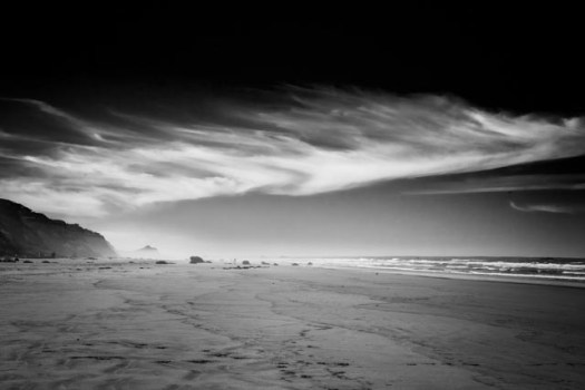 Clouds sculpted by the wind play over Ona Beach at South Beach State Park along the central Oregon coast.