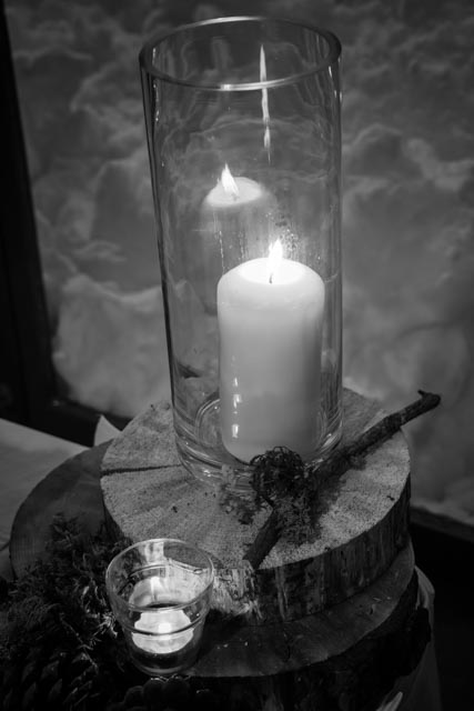 A decorative candle glows as part of a winter wedding celebration in Essex, Montana.