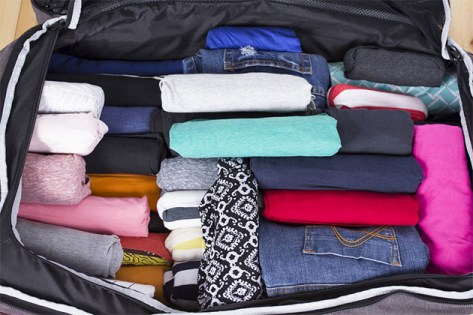 packed suitcase with clothes
