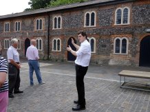 5-Our guide pointing out workers cottages