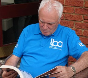 11-LBA Chairman, Terry Galvin engrossed in a book