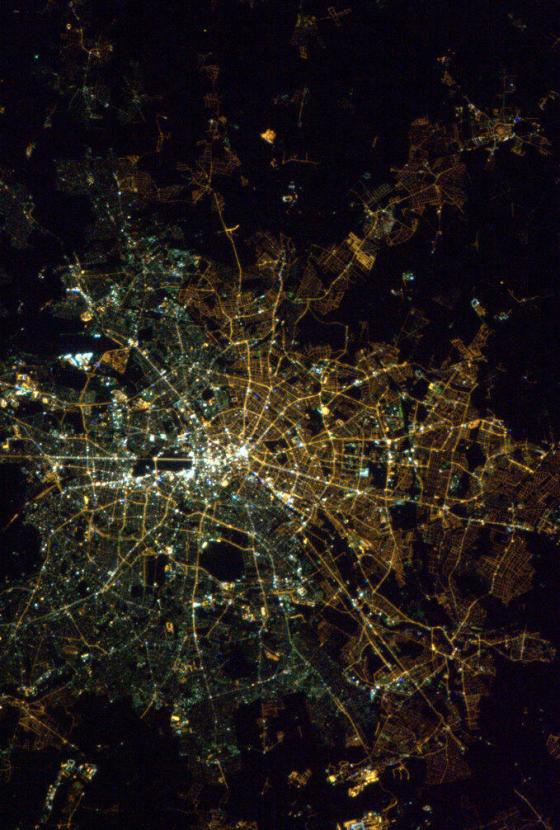 Berlin at night. Amazingly, I think the light bulbs still show the East-West division from orbit - Photo Chris Hadfield
