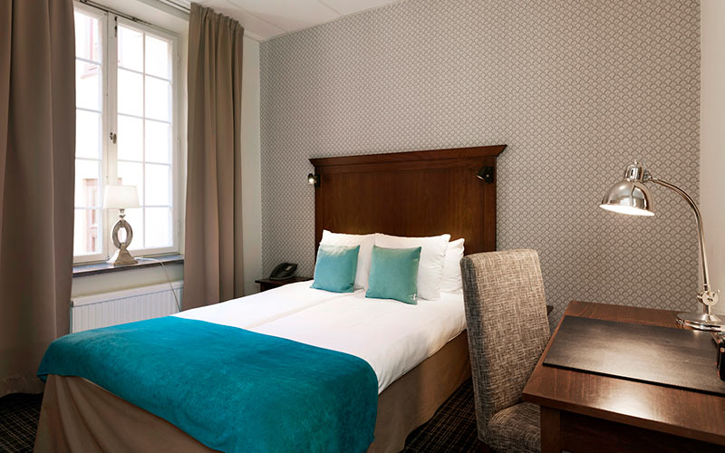 Attractive, slightly vintage hotel room.