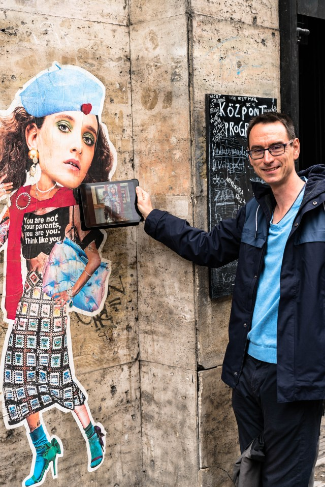 wall hat shirt skirt high heels and blue budapest street art