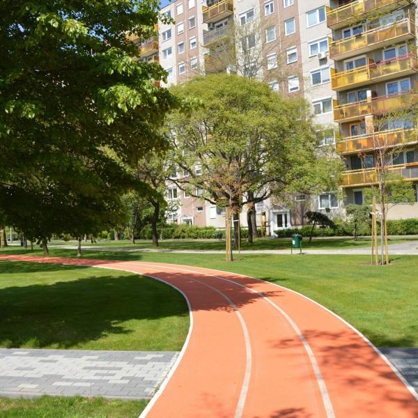 orange running track running through a city centre park