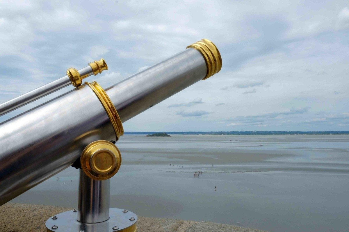 A telescope over looking the bay of Le Mont Saint-Michel