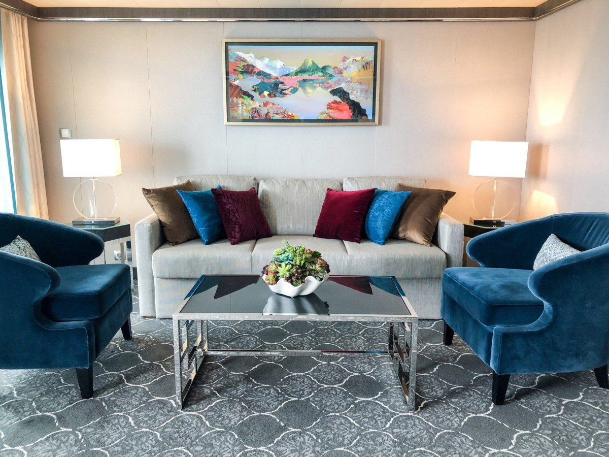Symphony of the Seas Grand Suite lounge area with sofa bed