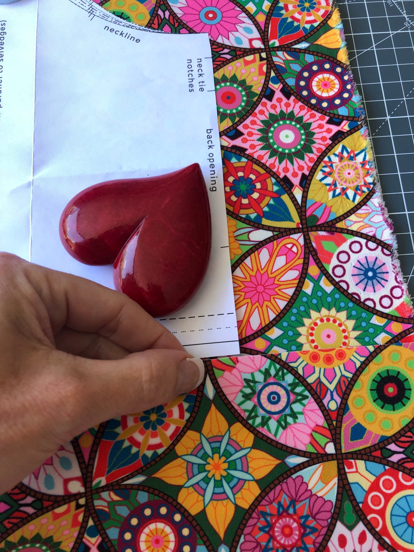 Make sure both sides of your pattern match. Cut one side and lay it next to the side you are cutting and line it up.
