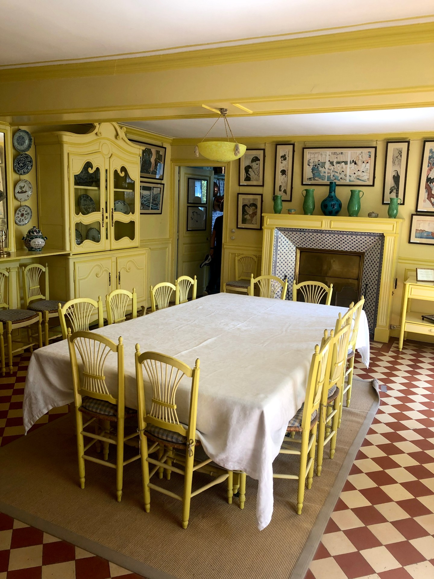 Claude Monets yellow dining room, Not only are the walls yellow but the furniture is too.