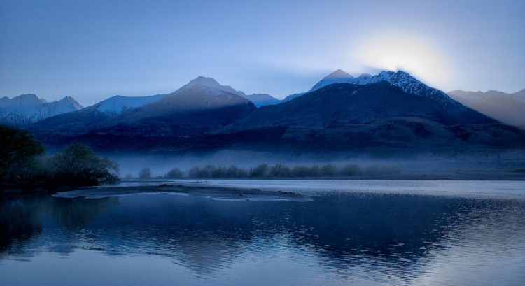 Where the Dart River in Mt Aspiring National Park, enters Lake Wakatipu. Taken by the Kinloch Lodge on the shores of same.