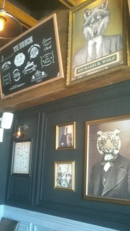 Strange and fascinating art at Wolf and Fox Gastropub's wall