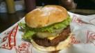 Hawaiian Burger with 7 oz. burger patty and a cheddar slice, Php. 385.00