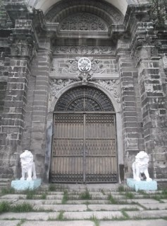The front door of the chapel with stone lions guarding it