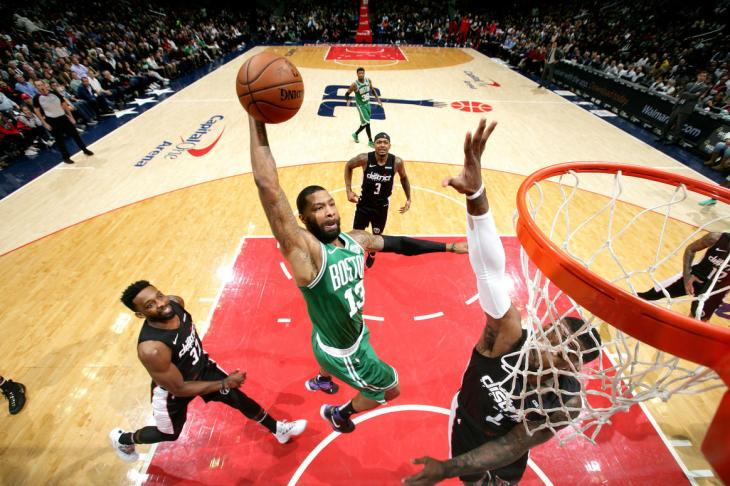 WASHINGTON, DC -  DECEMBER 12: Marcus Morris #13 of the Boston Celtics dunks the ball against the Washington Wizards on December 12, 2018 at Capital One Arena in Washington, DC. NOTE TO USER: User expressly acknowledges and agrees that, by downloading and or using this Photograph, user is consenting to the terms and conditions of the Getty Images License Agreement. Mandatory Copyright Notice: Copyright 2018 NBAE (Photo by Ned Dishman/NBAE via Getty Images)