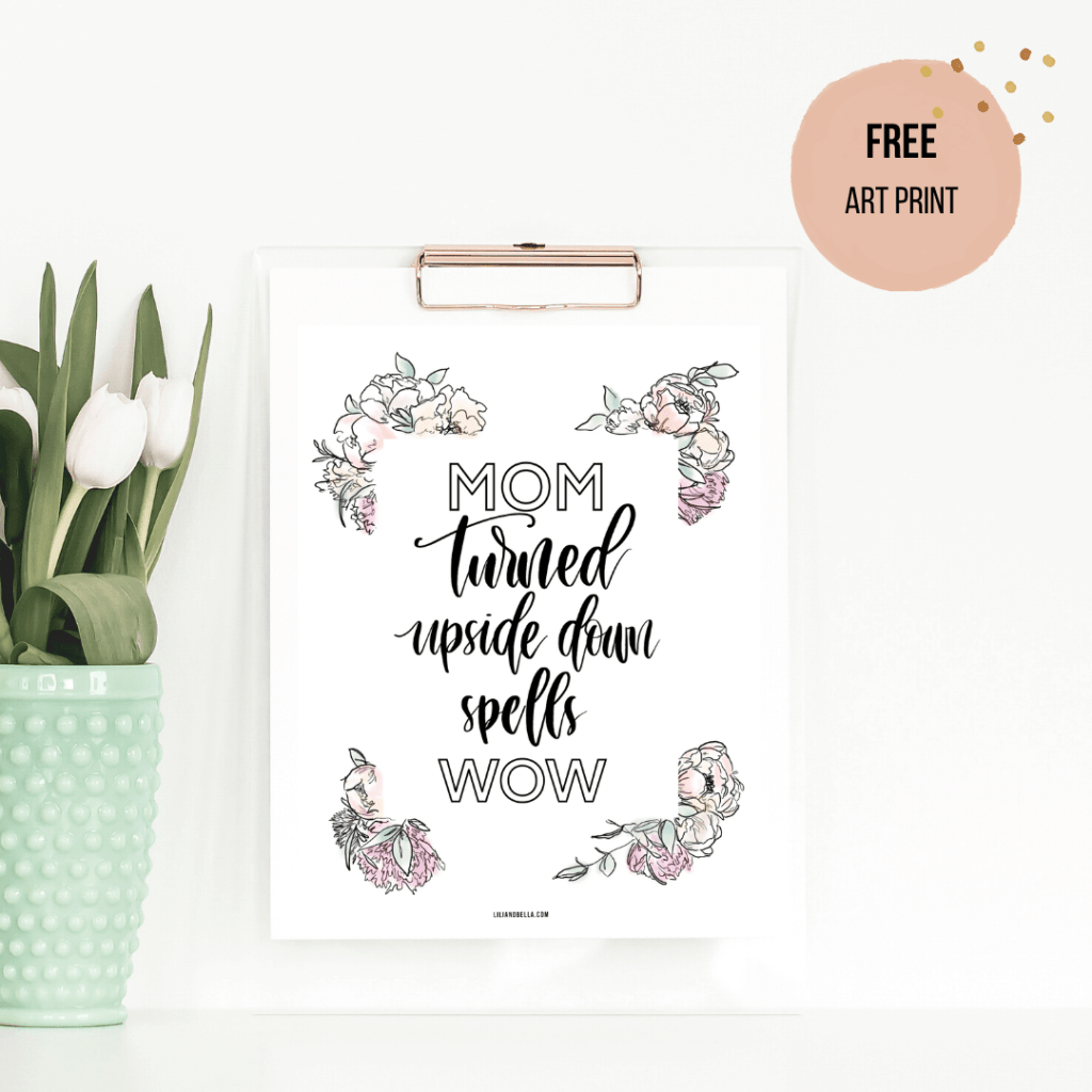 """Free art print in a frame that reads """"Mom turned upside down spells wow"""" in custom hand lettering font and a colourful floral border."""