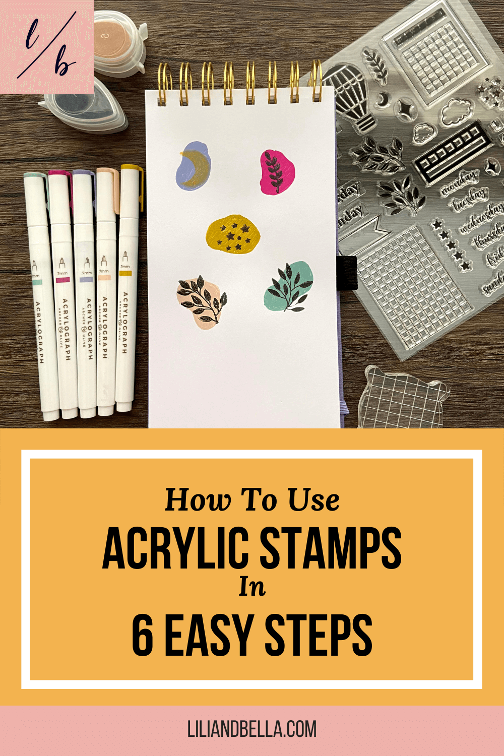 Acrylic stamps used to stamp floral designs, moon, and stars on an open page in an Archer & Olive sketchbook.