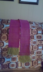 My first woven project! 100% wool scarf in purple and green. This is the yarn that came with my loom.