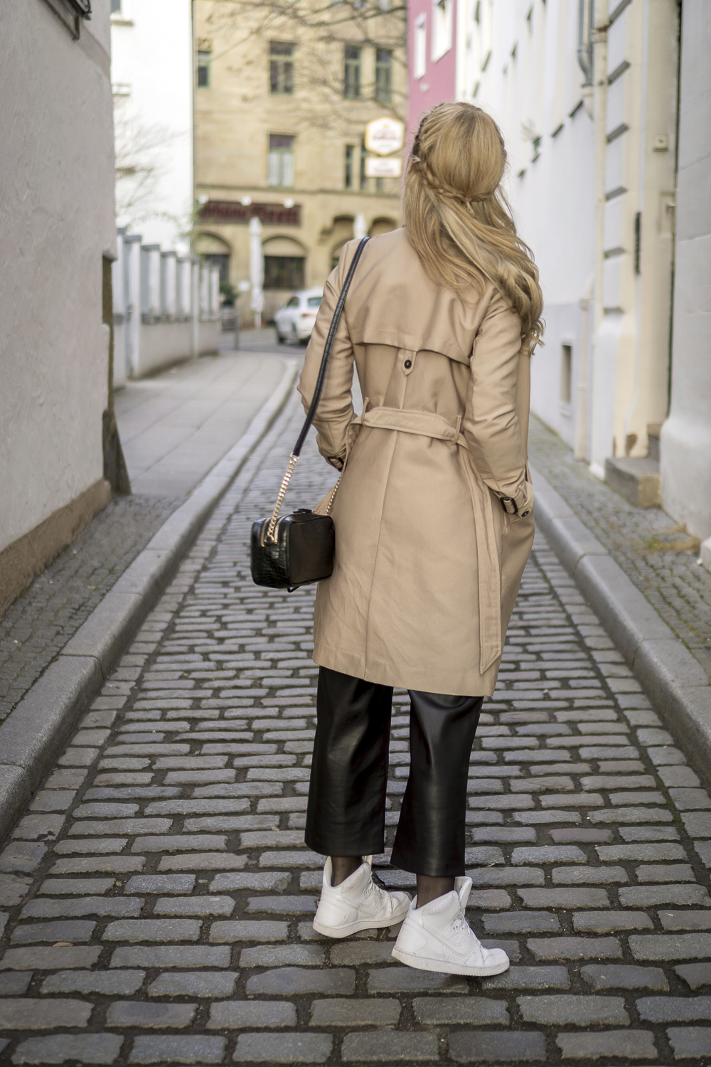 wearing beige trench coat from zara, white nike sneakers, mango leather pants. OOTD outfit lookbook