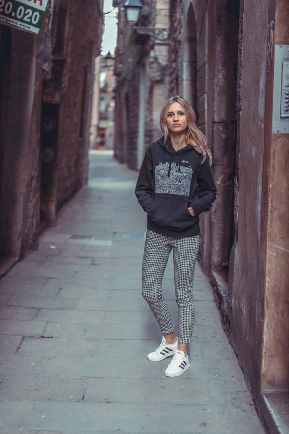 wearing uniqlo sweatshirt checkered pants adidas white sneakers pinko coat barcelona trip casual day ootd fashion street style