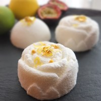 White citrus passion:  lemon-lime passionfruit mousse cakes recipe!  Decorated with white velvet spray!
