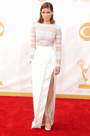 Kate Mara, of House of Cards, manages to make this beautiful white J Mendel number fierce and edgy. And notice how the gown hugs her curves wonderfully.