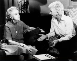 OVER EASY, from left, Lillian Gish, host Mary Martin, episode aired November 1, 1980 - 1977-83 - Miss Lillian Gish's book, Dorothy and Lillian Gish, displayed on the table