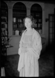 Nell Dorr (1893-1988); [Lillian Gish in library, wearing shawl on shoulders]; nitrate negative; Amon Carter Museum of American Art; Fort Worth TX; P1990.47.3508
