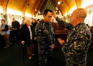 Sailors observe Ash Wednesday.