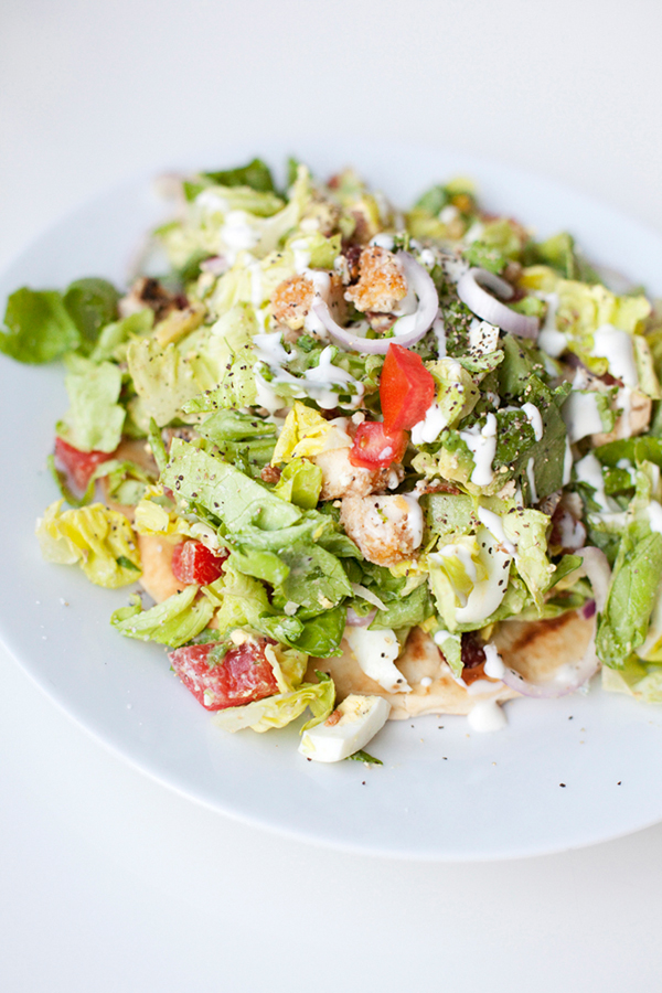 tossed cob salad on a pita