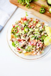 Nachos made with home-baked tortilla chips made from extra thin lower carb tortillas- you can have a whole dish and still eat light!