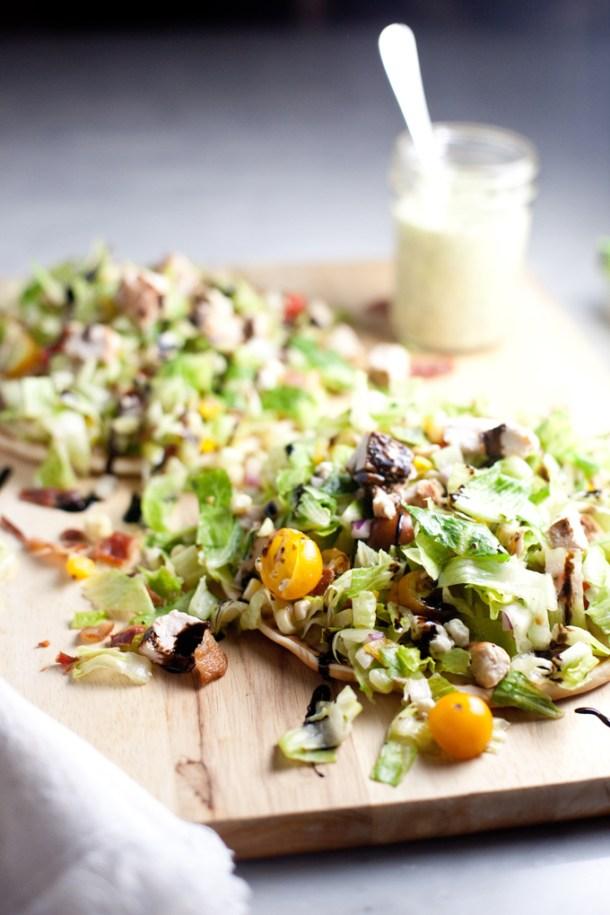 Fresh and Healthy Chopped BLT Salad atop a soft warm greek pita