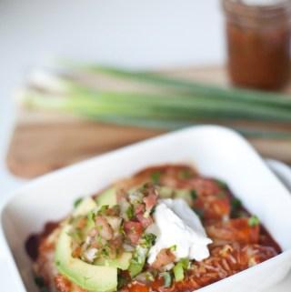 Skinny, Macro-Friendly Creamy Chicken Enchiladas- 500 calories for this whole pan! lillieeatsandtells.com