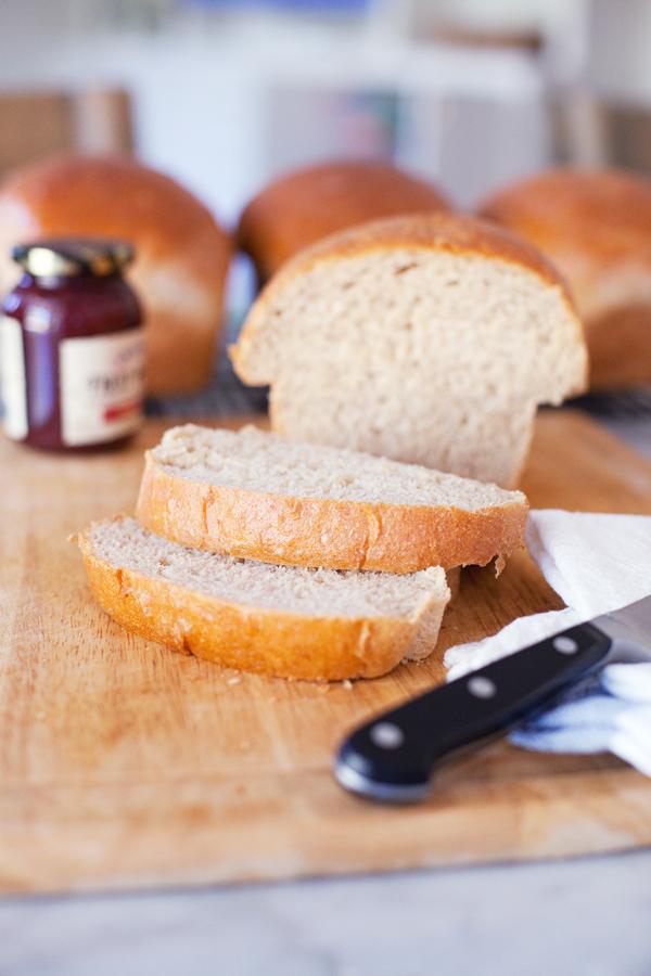sliced loaf of homemade wheat bread www.lillieeatsandtells.com