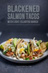 three salmon tacos on a plate