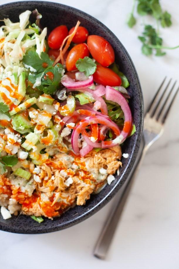 Quick and easy buffalo chicken grain salad bowl. www.lillieeatsandtells.com
