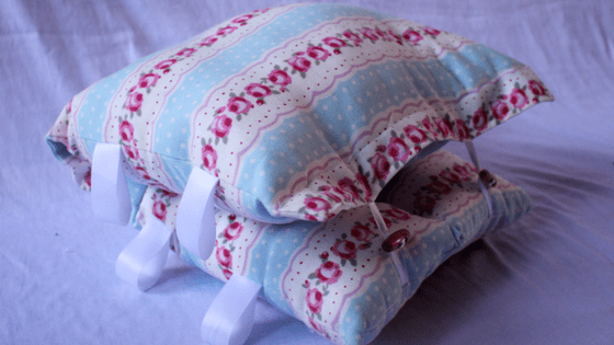 Blue and pink floral nursing pillow`