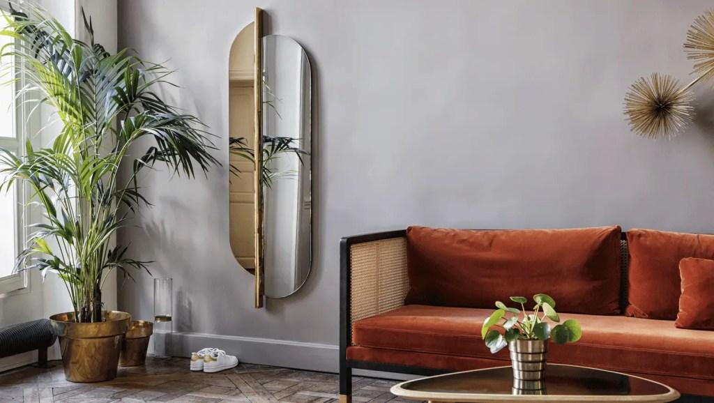 Miroir en hauteur découpé en deux partie une doré et une classique argenté