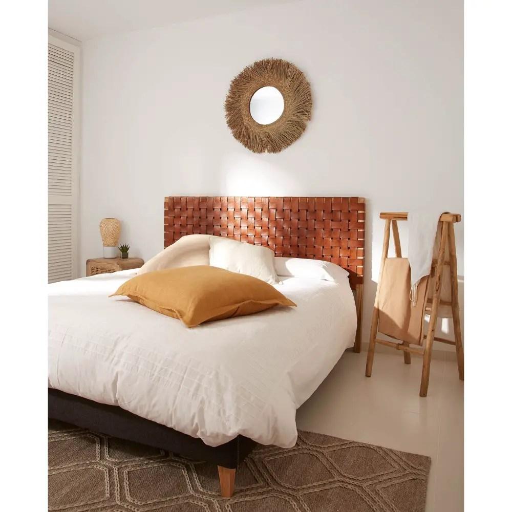 tête de lit en lanières de cuir croisées