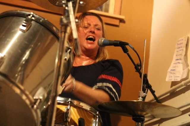 Jennifer hall playing drums with Ovarian Trolley