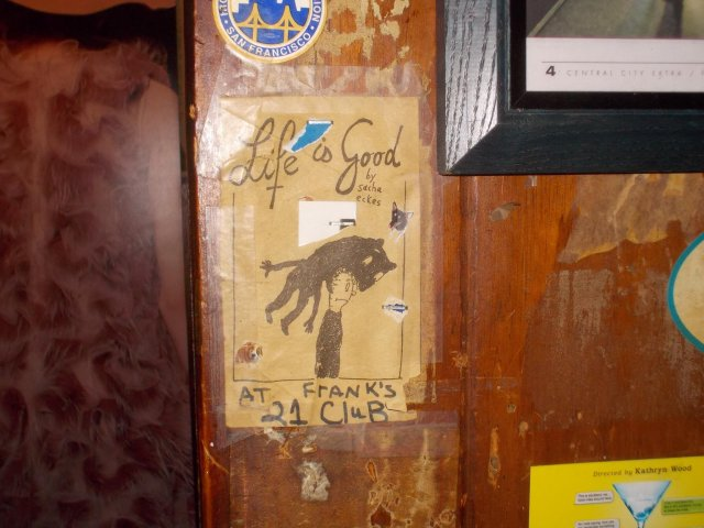 """life Is Good"" Sacha Eckes art hanging at Frank's 21 Club circa 2013 in San Francisco"