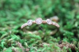 Three Bezel diamond band with tiny pave set diamonds
