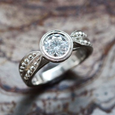 Leaf Band Engagement Ring with Round Brilliant Diamond shown in White Gold with Milgrain and Hand Beadwork Detail