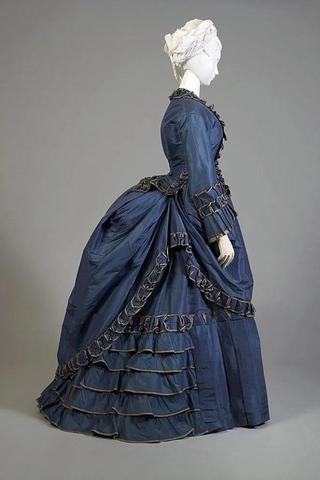 Here is another day dress, American, c. 1870 that illustrates the flow of the bustled skirt.