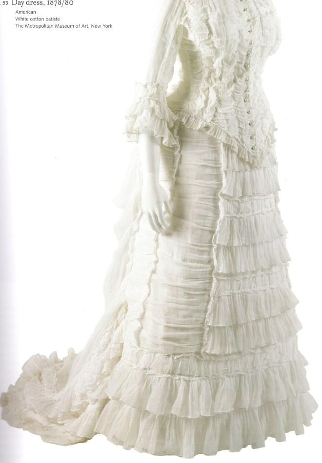 Day Dress c. 1878 - 1880, constructed of white cotton batiste; Metropolitan Museum of Art