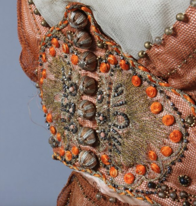 Close-up of bead work.