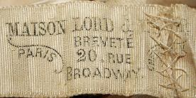 Dress label for Lord & Taylor done in a pseudo-French style.