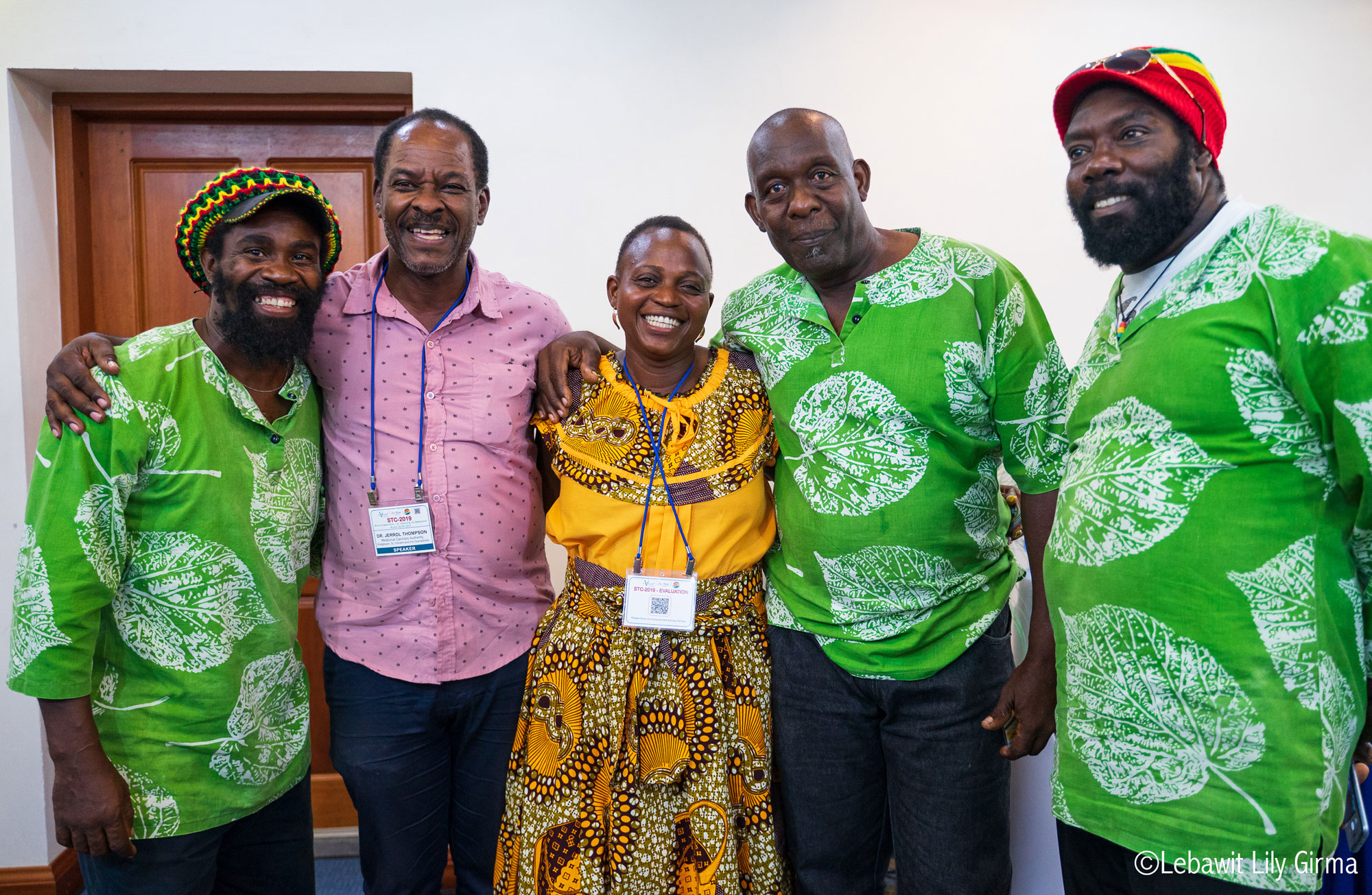 Five people in African print clothing